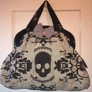 Iron fist purse and BETSEY Johnson make up bag .